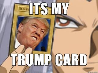 Man wielding donald trump card.jpg